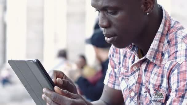black man looking to the digital tablet