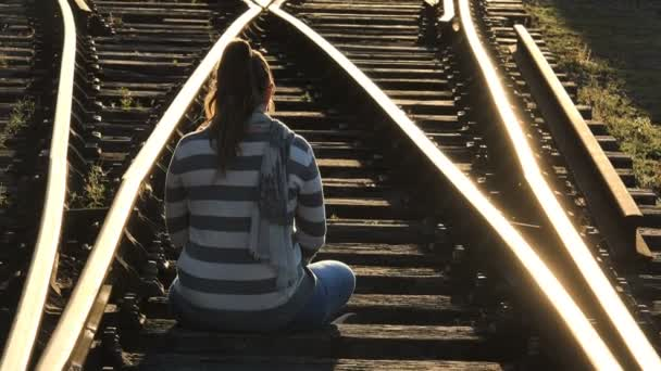 lonely woman sitting on the railtrack. Sadness,depression,thoughts