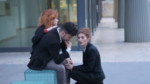 dismissal, bankruptcy. Two young business women comfort their fired colleague