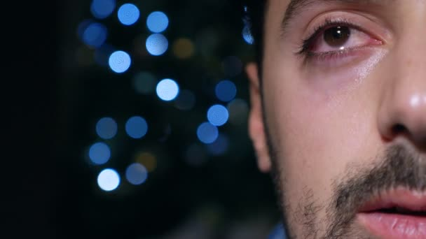 depressed lonely young man crying in the dark  at christmas