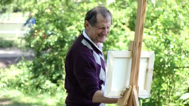 starý malíř v parku Malování přírodní krajina