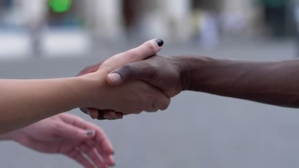 white woman hands holding black mans hand.Love,multicultural- slow motion