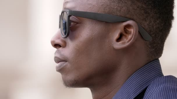 Confident succesful black man take off sunglasses and staring at camera