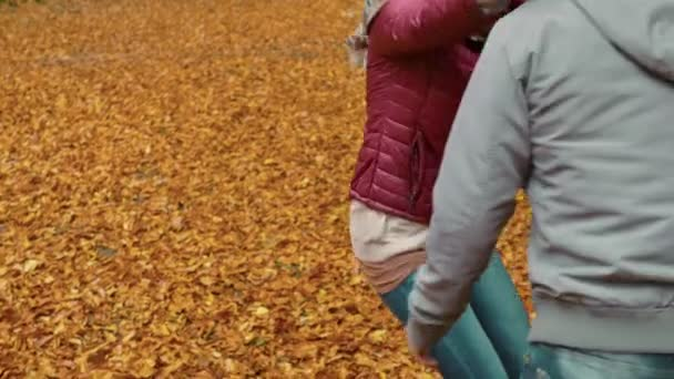 sweet and passionate embrace between lovers at the autumn park
