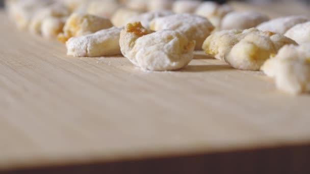 skillful hands preparing gnocchi typical Italian pasta
