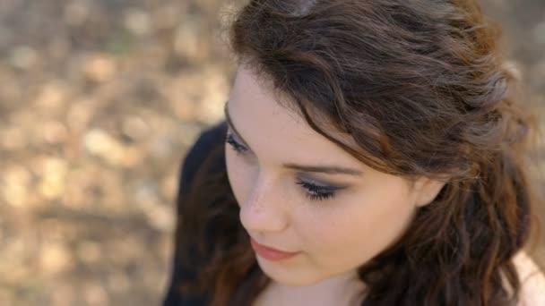 youth, beauty-young beautiful woman at park smiling at camera