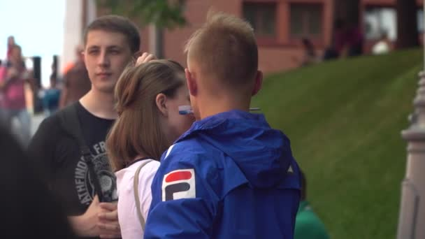 Russia, Moscow, 1 July , 2018. Soccer fan with Russian flag painting on face.