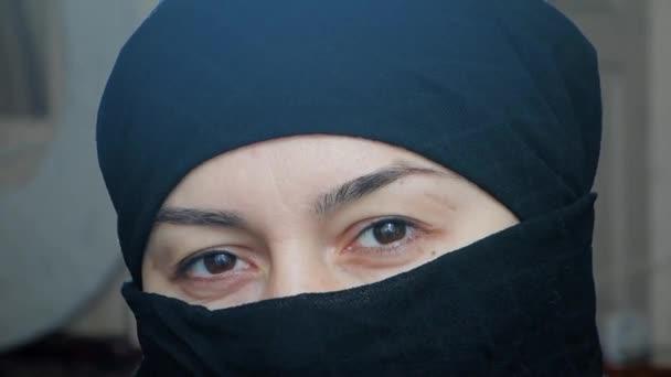 Portrait of a beautiful arab girl. An Islamic woman in a hijab looks into the camera.