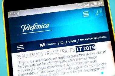Berdyansk, Ukraine - 10 May 2019: Illustrative Editorial of Telefonica website homepage. Telefonica logo visible on the phone screen.