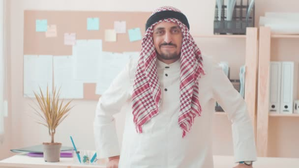 office work cheerful Arab man smiling. businessman working in office