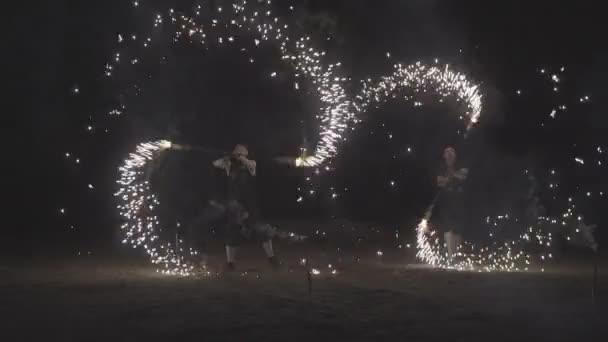 Fire dancers Swing fire dancing show fire show on the beach dance man juggling with fire
