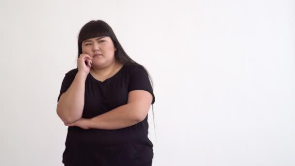 pensive Asian girl plus size on white background.