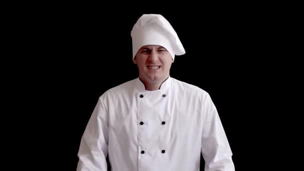 emotionaler weißer männlicher Koch jubelt und schreit in die Kamera
