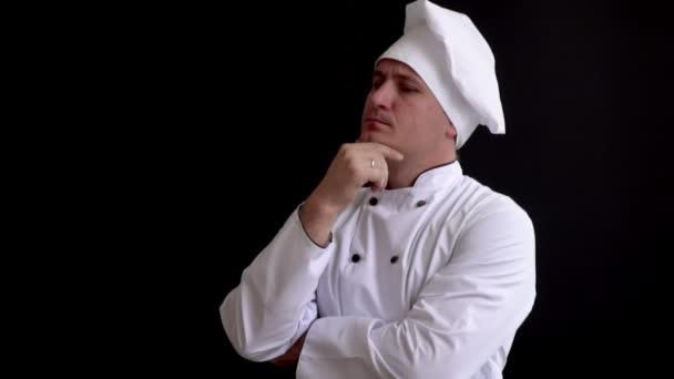 Porträt eines nachdenklichen männlichen Kochs, der wegschaut