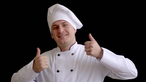 pro dospělé kuchař v bílém obleku a čepici na tmavém pozadí