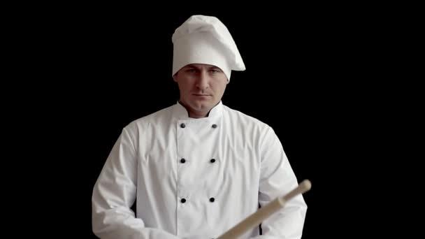 zlého šéfkuchaře drží nádobí jako zbraň. koncept nápad, vtipné prezentace