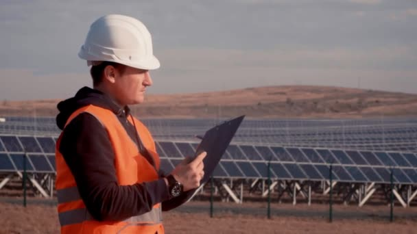 young man engineer checking solar panel at solar power plant