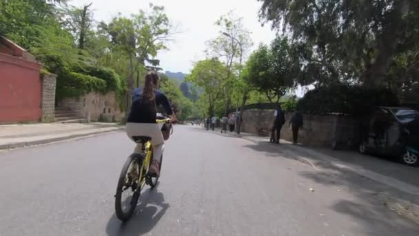 Turkey , Istanbul, Prince Island ,2019, Girl tourist on a Bicycle travels through the picturesque streets of a beautiful city