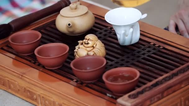 A beautiful set for the tea ceremony, small cups poured fragrant tea