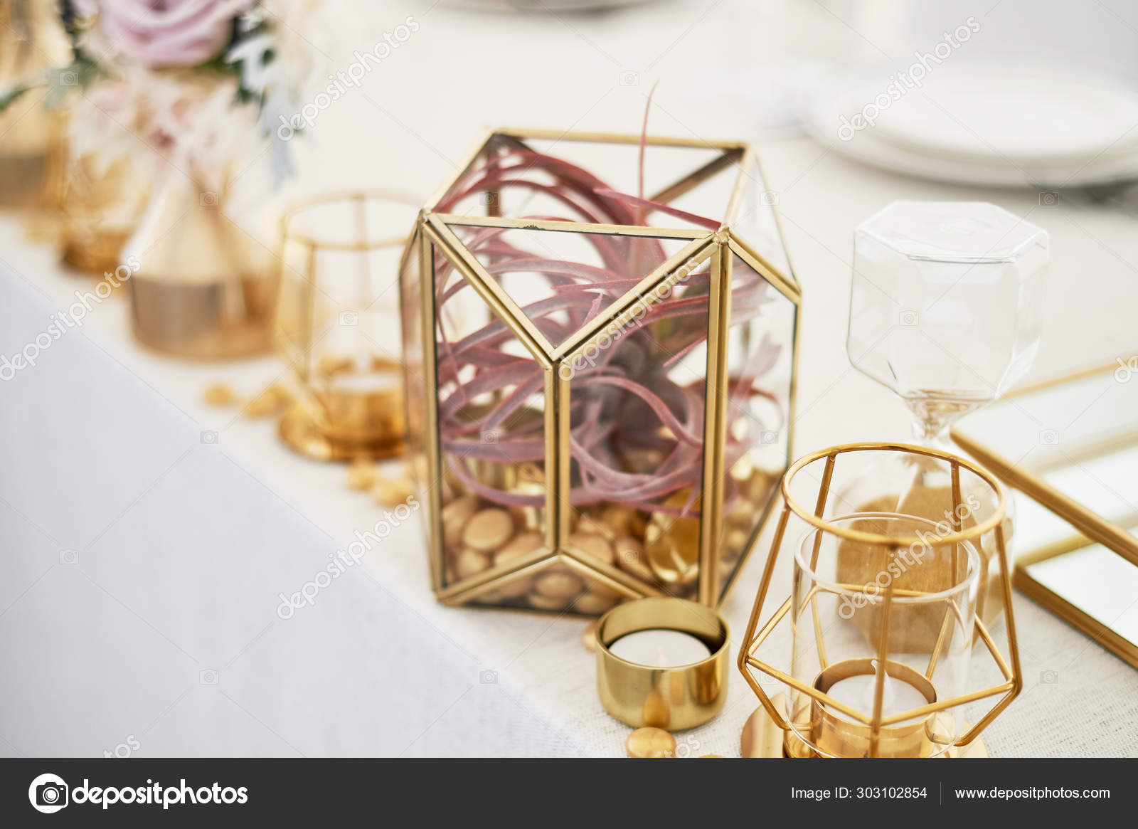 Wedding Decoration In Boho Style Light Colors In The Tent Wedding Table Decorated With Gold Geometric Candlesticks Simple Form Stock Photo C Gf2002 Mail Ru 303102854