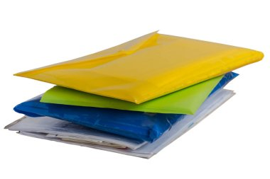 Stack of colorful folders with documents isolated on white background.