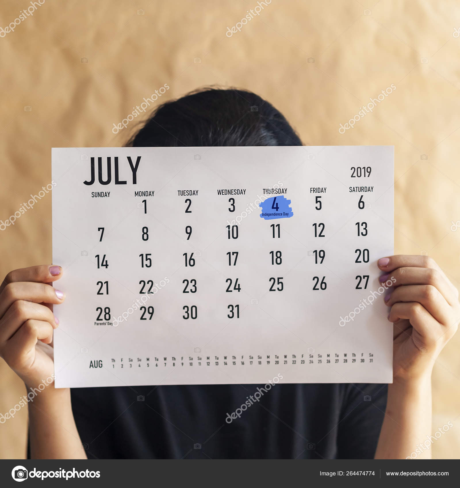 July 4 2019 Calendar Woman holding calendar with marked day July 4, 2019   US