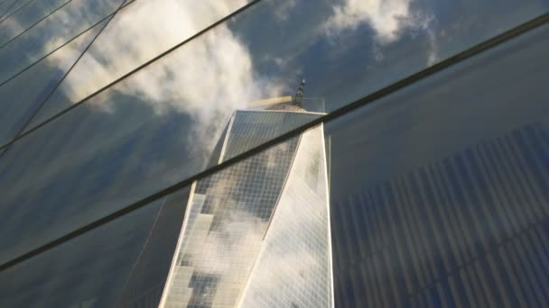 NEW YORK, NEW YORK, USA  SEPTEMBER 15, 2015: one world trade center reflected in a skyscraper in manhatten new york