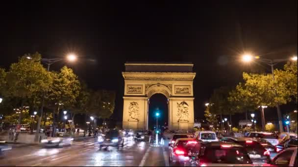 PARIS, FRANCE- SEPTEMBER 19, 2015: a time lapse of the arc de triomphe de letoile and traffic on the avenue champs de elysees