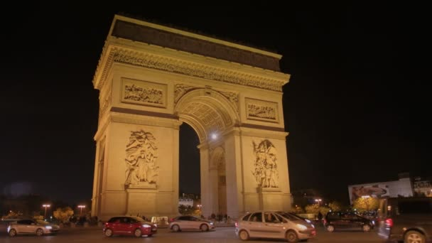 PARIS, FRANCE- SEPTEMBER 19, 2015: a nighttime close up view of the arc de triomphe de letoile, one of the most famous monuments in paris