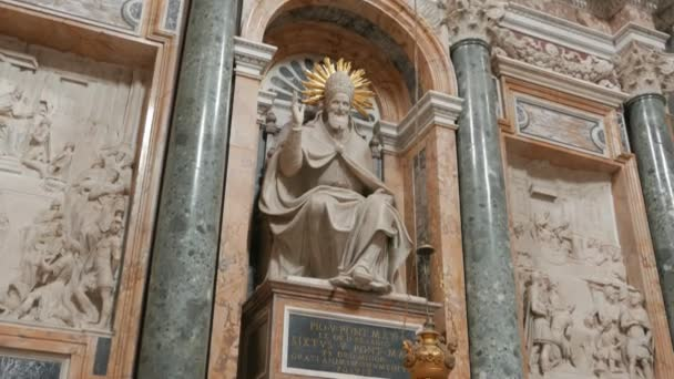 ROME, ITALY- SEPTEMBER 30, 2015: a tilt down shot of a statue of a pope inside the basilica  santa maria maggiore in rome, italy