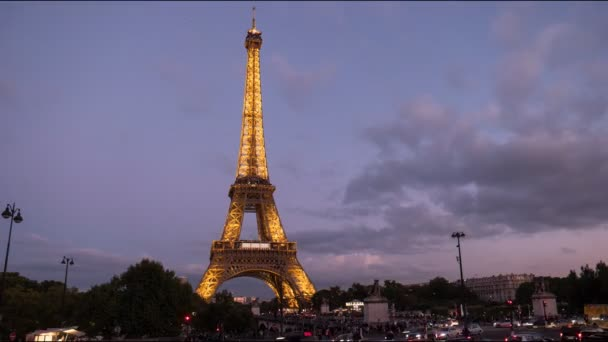 PARIS, FRANCE- SEPTEMBER 19, 2015: a dusk time lapse of the eiffel tower, one of the most famous monuments in paris