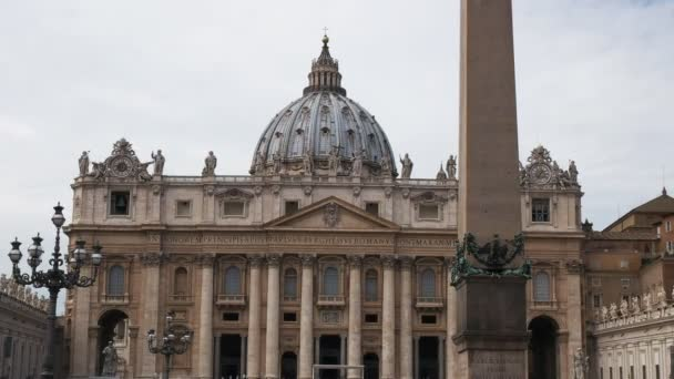 close up of the obelisk and saint peters basilica in rome, italy