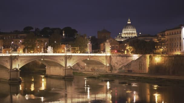 st peters and tiber river at night in the city of rome, italy