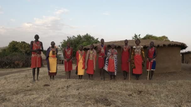 NAROK, KENYA- AUGUST, 28, 2016: wide view of a group of maasai women and men singing
