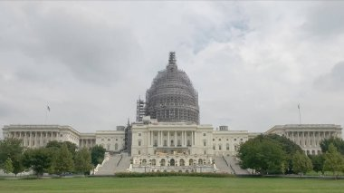 the exterior of the us capitol undergoing renovations in washington