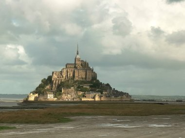 MONT ST MICHEL , NORMANDY, FRANCE- SEPTEMBER 22, 2015: sunshining between storm clouds on mont st michel, france