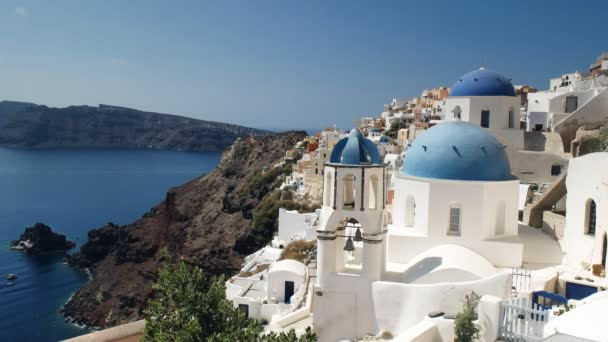 wide shot of the famous three domes in oia, santorini