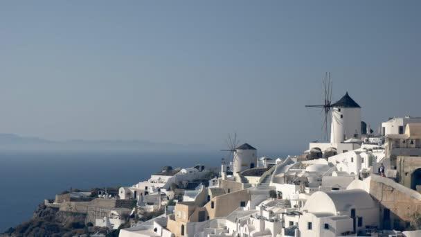 houses and windmills at oia on santorini