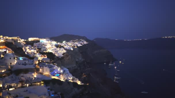 night pan from the town of fira to oia on the island of santorini
