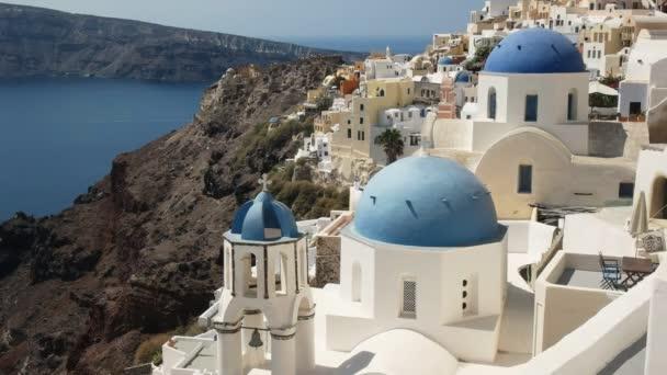 famous three blue church domes in oia, santorini