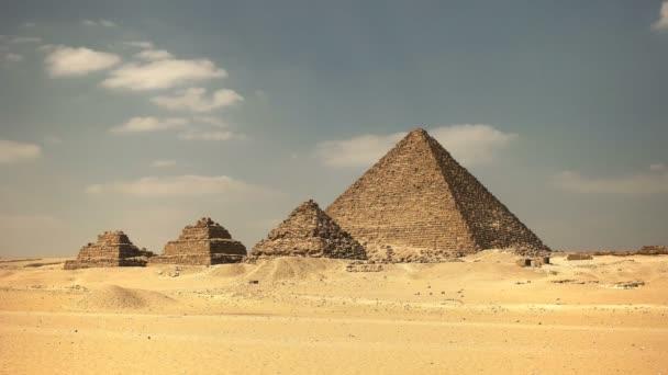wide shot of pyramids at giza near cairo