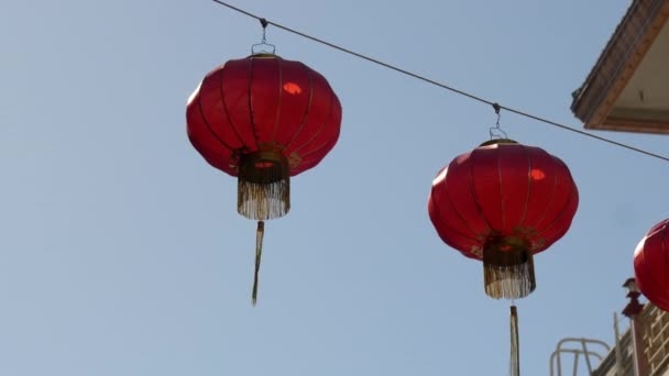 close up of red lanterns hanging in chinatown of san francisco