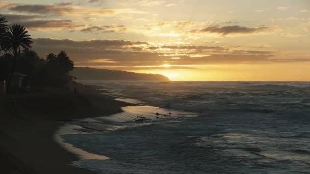 naplemente lövés a nap mögött felhő kaena pont Hawaii