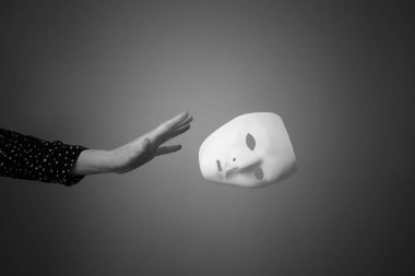 The mask is a symbol of duplicity.