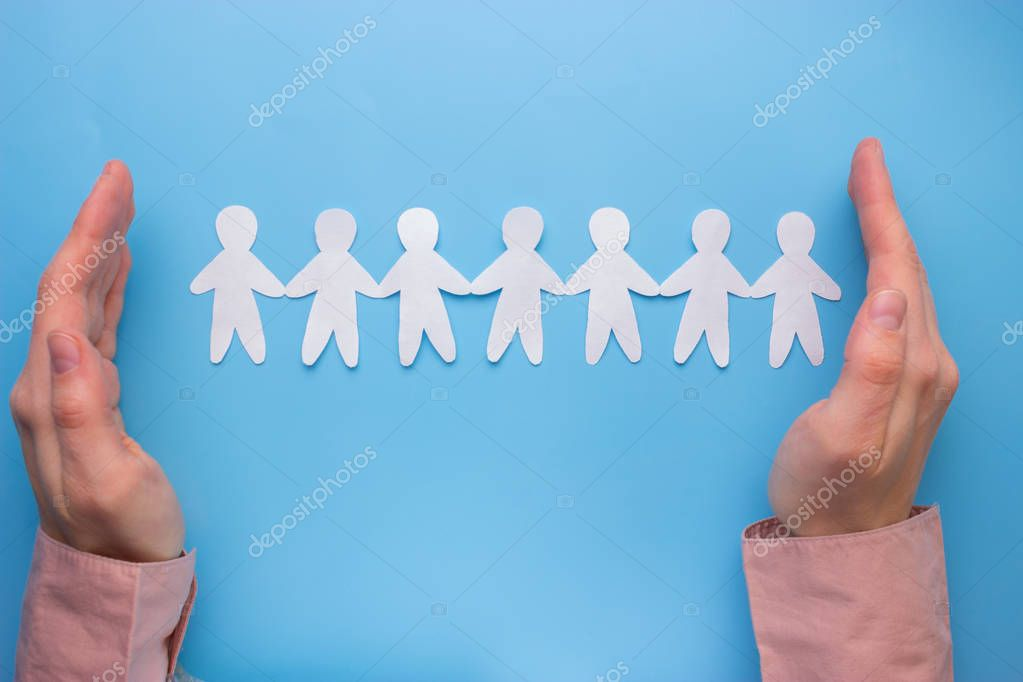 Paper people on the blue background. together possible