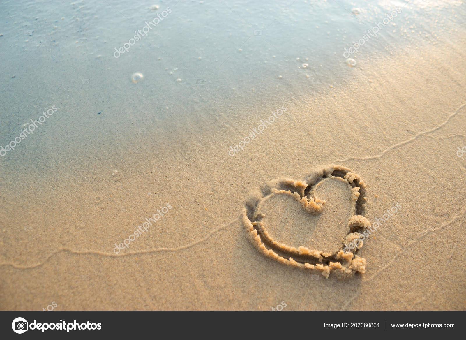 heart symbol sand beach love ocean concept stock photo pox na