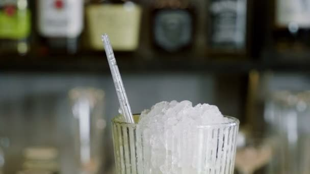 Caipirinha cocktail. The barman preparing an alcoholic drink in a bar. 4K