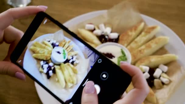 Rice gruel, cheese cakes. Hands taking photo of breakfast food by smartphone. 4K