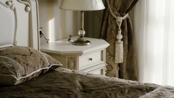 The interior of an elegant bedroom. Close-up shot of furniture at sleeping room. Slow motion. HD