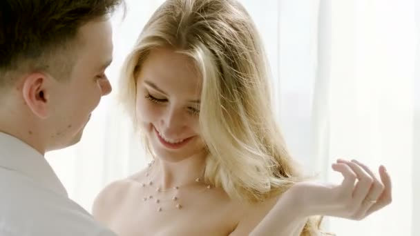 Close-up shot of an attractive young happy woman and smiling handsome man laughing and dancing together. 4K